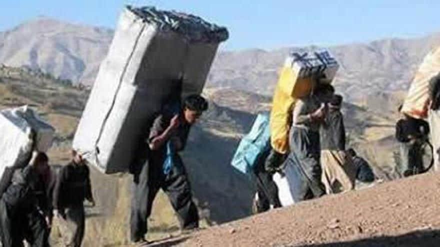 kolbars carry heavy loads through mountainous terrain.