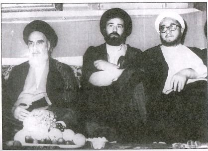 "Ayatollah feast. First from right, Sadegh Khalkhali, known as Iran's ""Hanging Judge."" Third from right, Ruhollah Khomeini, the Supreme Leader of Iran."