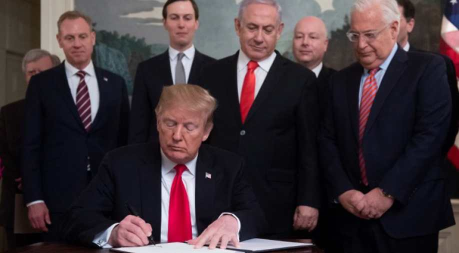 President Trump signs the Golan Proclamation while Israel PM Netanyahu looks over