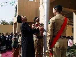 muhammad zeeshan ahmad raises flag. Photo by Waqar Naseem Wamiq