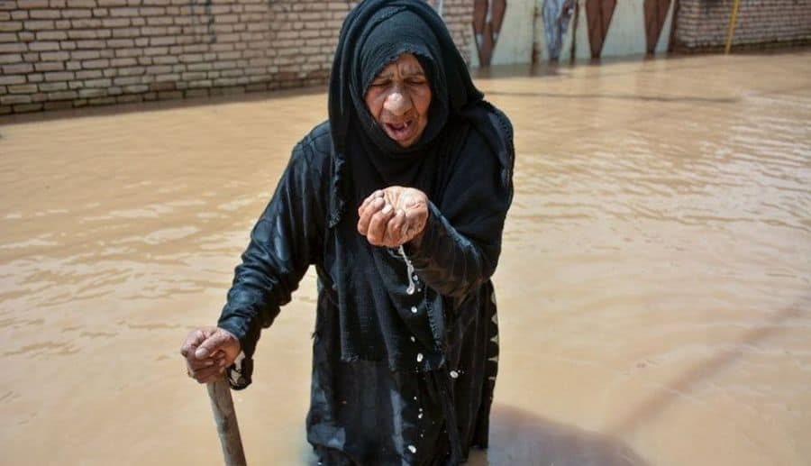 iran - woman in flooded street