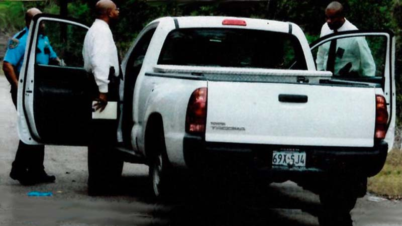Death Truck: Investigator James Bonaby (left) and Sgt-Investigator Myron Dillingham (right) examine the vehicle where Perry Barefield was found murdered.