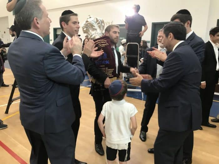 Dancing with the Torah, young and old