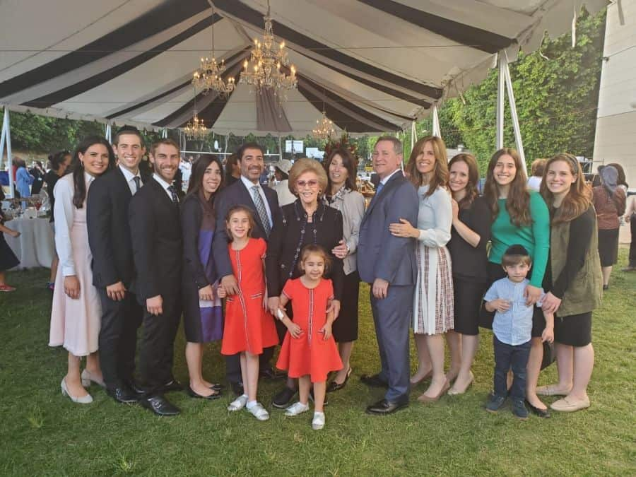 Teichman Family-Center Left-son Dubby, Matriarch Ruth, daughter Ahuva, son Alan and all the extended family at the Emek Academy grounds during the Torah Scroll Introduction