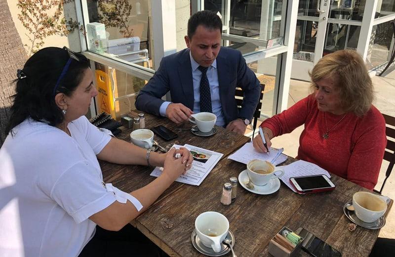 left to right durdane agayeva gulmammad mammadov and the writer hearing their Nagorno-Karabakh Refugees stories photo credit nurit greenger