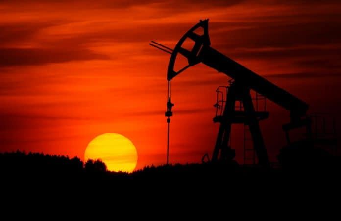 oil pump. photo by Zbynek Burival on Unsplash