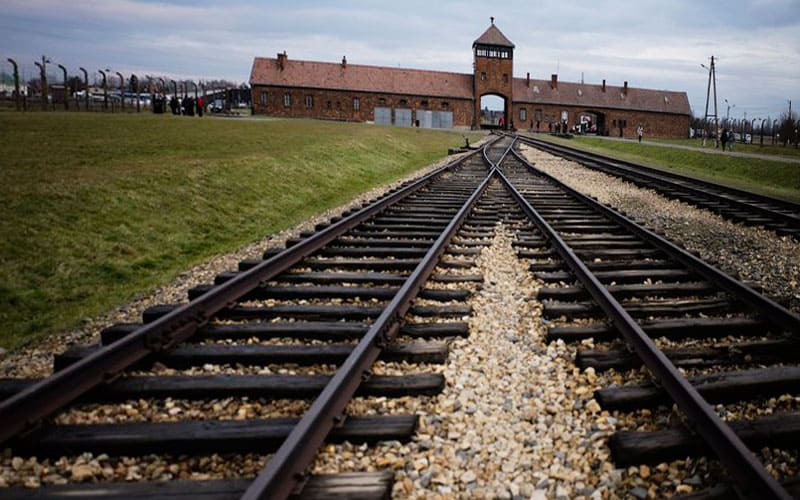 tracks lead into auschwitz death camp entrance