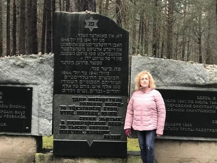 The writer in front one of the Paneriai-Ponar memorial monuments - Photo credit Nurit Greenger