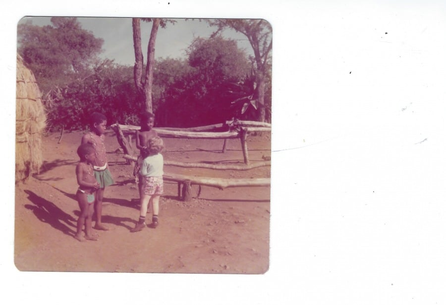 On a country trip, my son is doing forbidden mingling while visiting with Zulu craal (village) kids, May 1976 - Photo credit Nurit Greenger