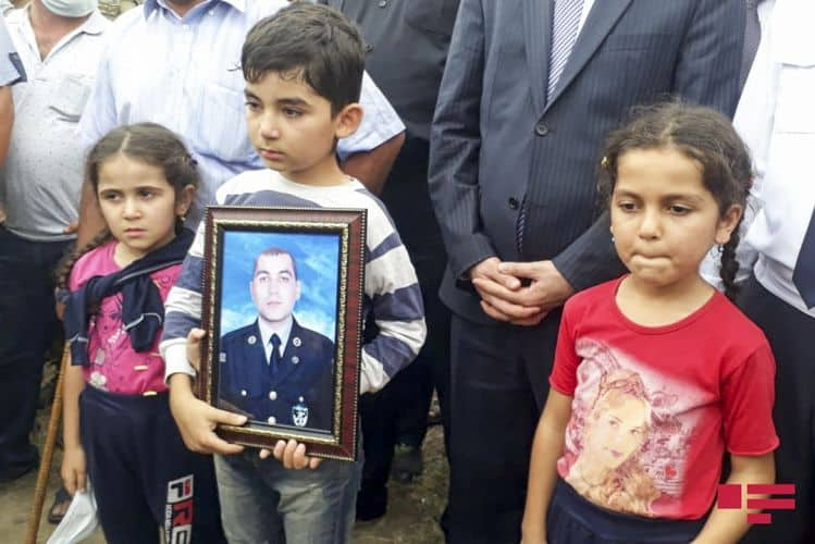 Azerbaijani kids hold the photo of heir father, killed in the July 2020 Armenian military hostility on Azerbaijan - Photo provided by the Azerbaijan General Consulate Los Angeles