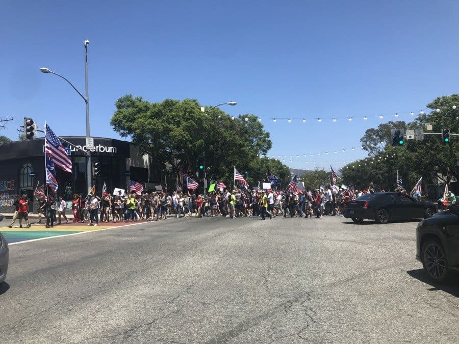 Rally crowd marching from corner of Santa Monica Blvd and San Vicente toward Beverly Hills rally venue - Photo credit Nurit Greenger