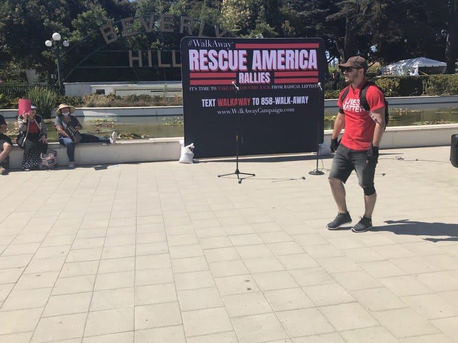 Rescue America rally, Drew Hernandez, Host of Lives Matter speaks - Photo credit Nurit Greenger