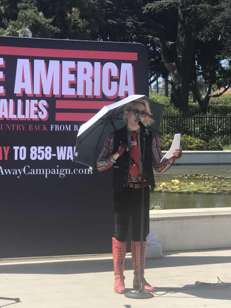 Rescue America rally, Ricky Rebel, Singer-Commentator speaks - Photo credit Nurit Greenger