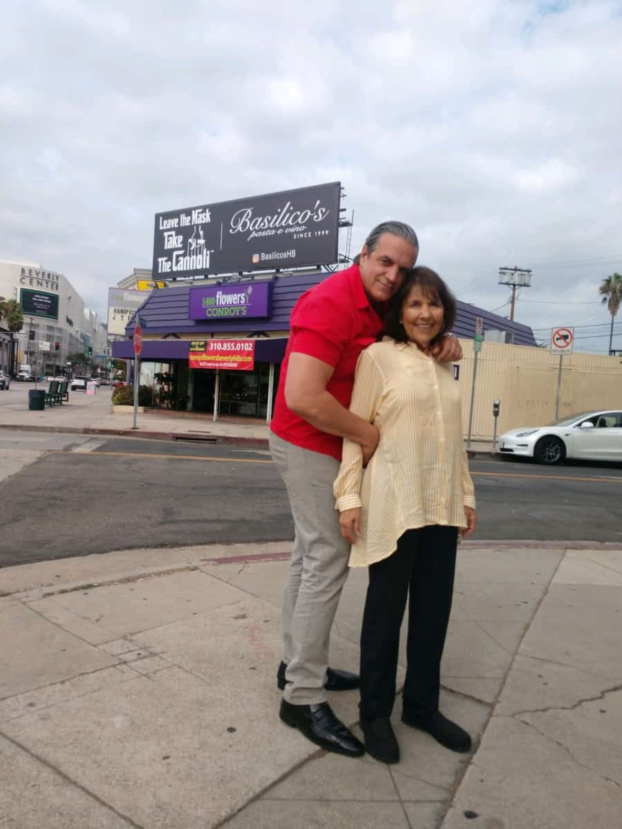 Tony Roman and Mom Rosemarie under the meaningful billboard they leased, in Los Angeles County - photo credit Tony Roman