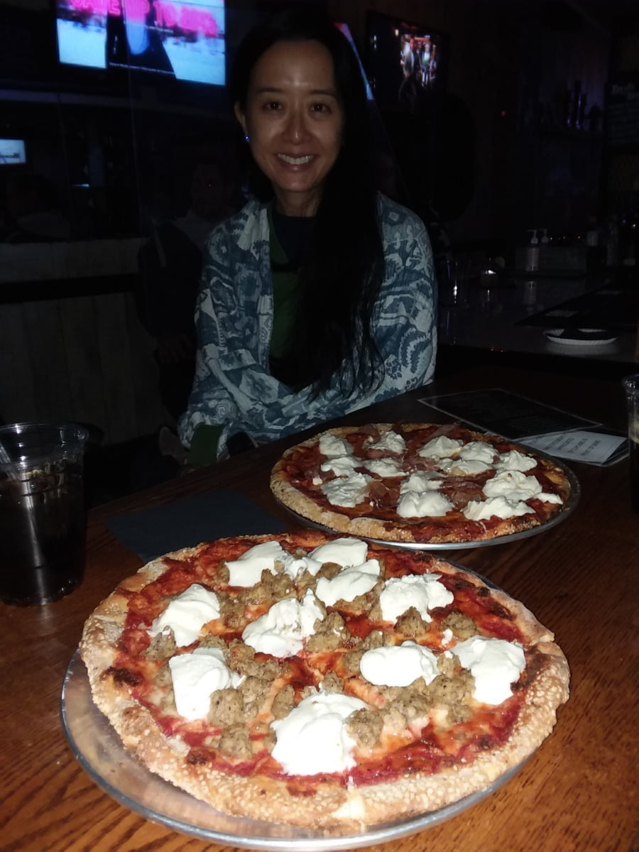 Peggy with Handmade Pizza at Prohibition Bar. Photo by David Pambianchi.