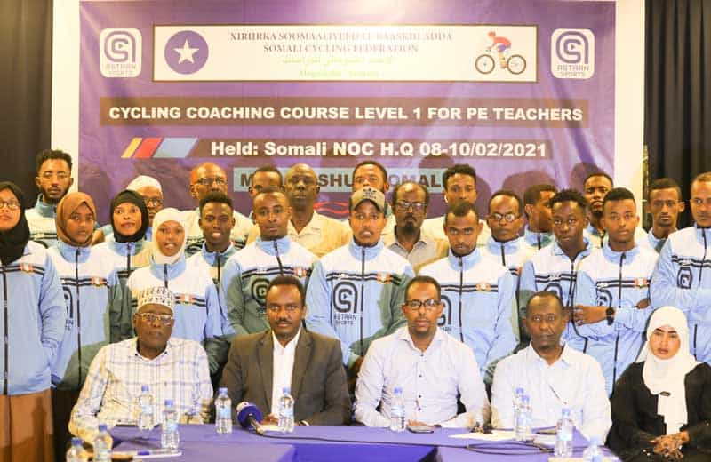 Minister ofSport Mohamed Haji Ibrahim Ali NOCSOM Secretary General Mohamed Abdo Hajji and Cycling Federation President Ahmed Mohamed Hassan with trained coaches. Photo by Osman Ibrahim