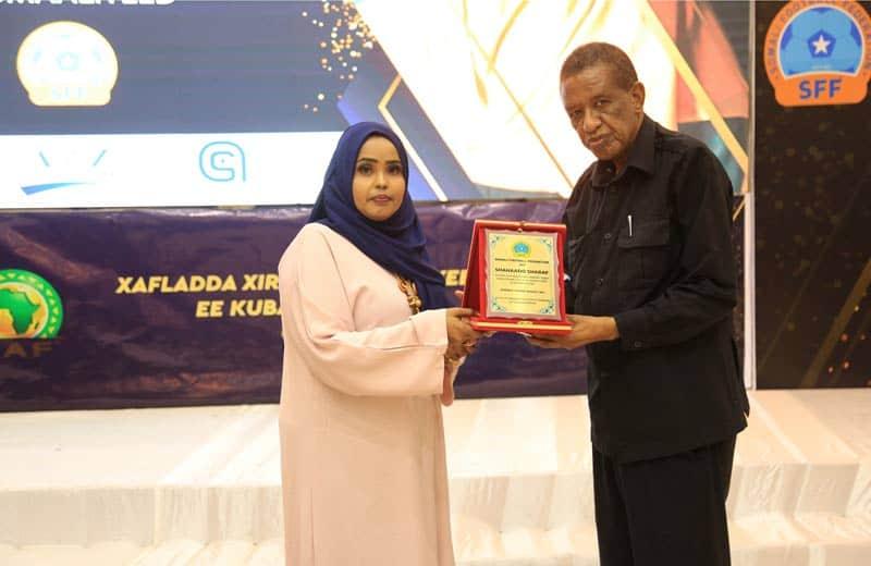 sff exco member mss fahmo kuulle ali receives award from deputy minister finance prof abdullahi sheik ali Photo: Omar Ibrahim Abdisalam