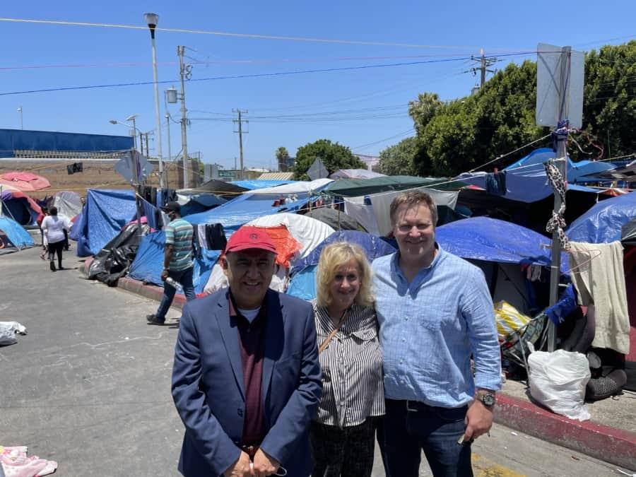 At the migrant tent town, border crisis. L - Bishop Juan Carlos Mendez, the writer and Attorney John Pierce - Photo credit Nurit Greenger