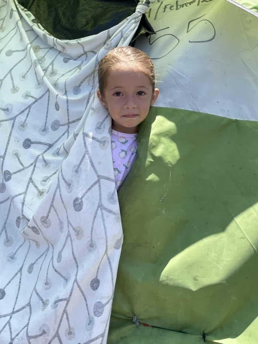 Migrating kids - little Melanie in her tent - Photo credit Nurit Greenger