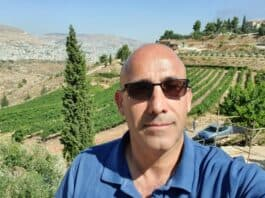 Amir Avivi, Brigadier General (ret.) in the Combat Engineering Corps of Israel Defense Forces (IDF) who is the Founder and CEO of Habithonistim, with Jerusalem hills background - Photo credit Amir Avivi
