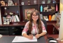 Dr. Sam at her desk in her office - Photo credit Nurit Greenger