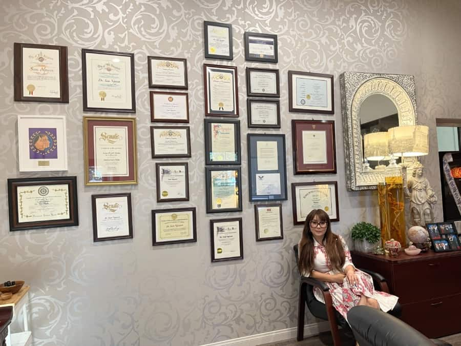 Dr. Sam in her office, wall covered with awards and certificates of acknowledgements - Photo credit Nurit Greenger