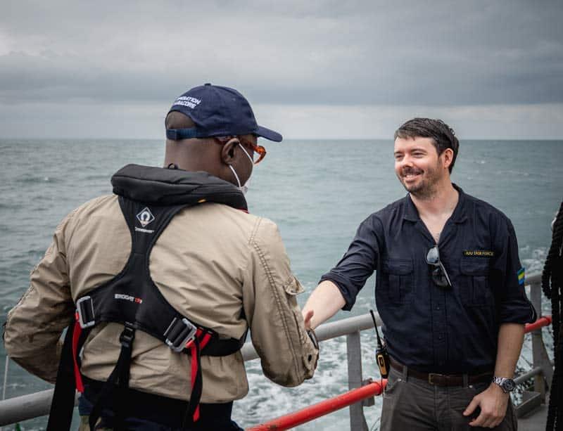 Peter and Gabon fisheies minister handshake. Photo by Sea Shepherd Global.