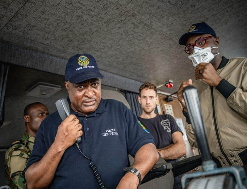Fisheries inspector calls a boat with minister. Photo by Sea Shepherd Global.