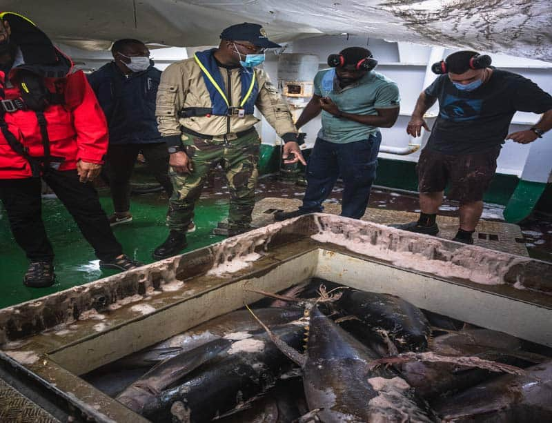 Fisheries Minister of Gabon in cargo holds on purse seiner Montecelo during inspection. Photo by Sea Shepherd Global.