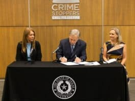 texas governor abbott ceremonially signs anti-fentanyl legislation into law in houston. public domain photo.