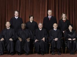 The Roberts Court, April 23, 2021 .Seated from left to right: Justices Samuel A. Alito, Jr. and Clarence Thomas, Chief Justice John G. Roberts, Jr., and Justices Stephen G. Breyer and Sonia Sotomayor. Standing from left to right: Justices Brett M. Kavanaugh, Elena Kagan, Neil M. Gorsuch, and Amy Coney Barrett. .Photograph by Fred Schilling, Collection of the Supreme Court of the United States