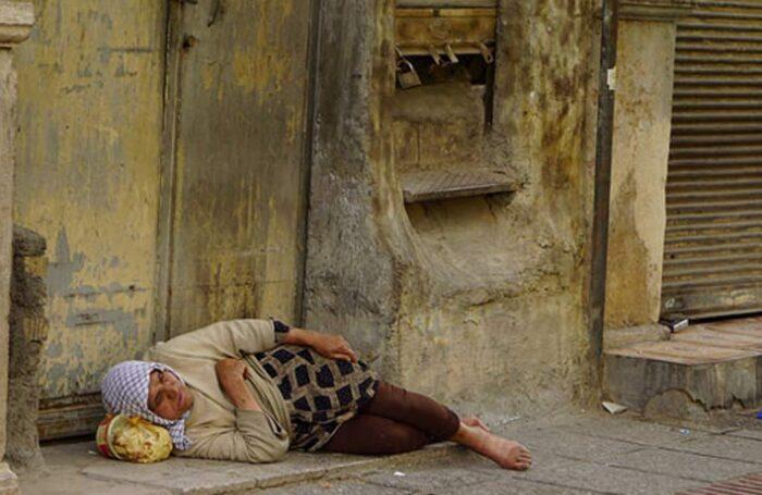 iran woman sleeping in the street
