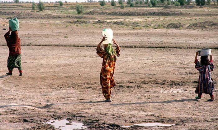 women carrying water in iran
